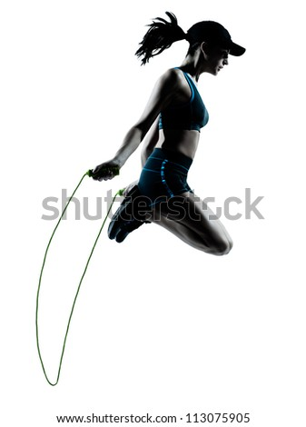 one caucasian woman runner jogger jumping rope in silhouette studio isolated on white background