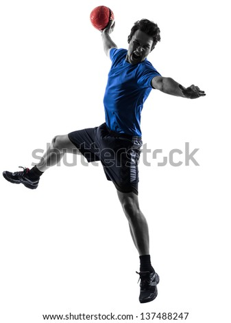 one caucasian young man exercising handball player in silhouette studio isolated on white background