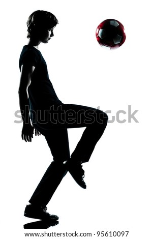 one caucasian young teenager silhouette boy girl  juggling soccer football full length in studio cut out isolated on white background