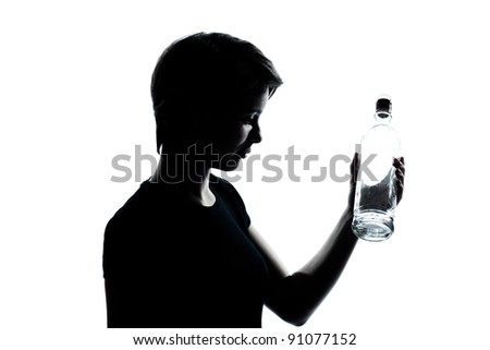 one caucasian young teenager silhouette boy or girl portrait holding empty vodka alcohol bottle in studio cut out isolated on white background