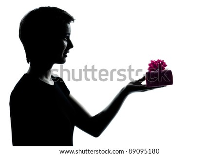 one caucasian young teenager silhouette girl offering present gift  portrait in studio cut out isolated on white background