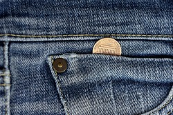One cent USA money ,in the blue jeans pocket close up