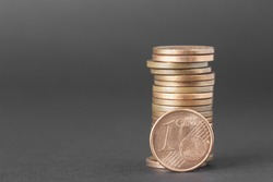 One cents of euro isolated on a dark background to understand a business concept