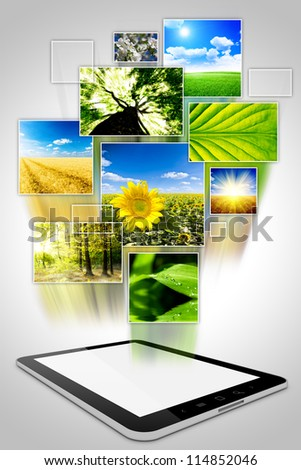 one computer tablet with photo collage of nature isolated on white background