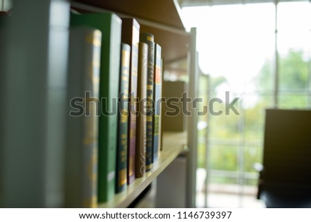One corner of the office is a bookshelf and library is blur,the atmosphere of the relaxation room.