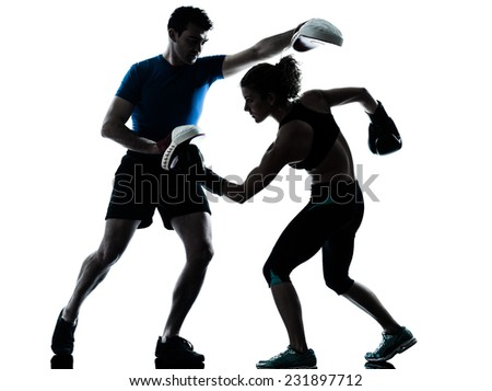 one  couple man woman personal trainer coach man woman boxing training silhouette studio isolated on white background