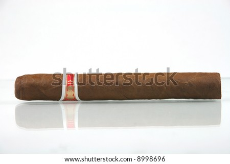 one cuban cigar with reflection in white background