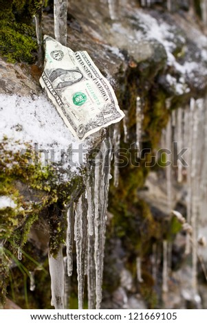 one dollar bill on the edge of a slippery cliff. concept for fiscal cliff