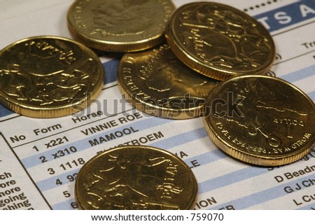 one dollar coins over newspaper