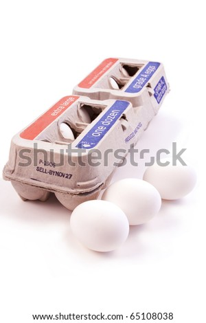One dozen eggs in a carton isolated on white background with three eggs - stock photo