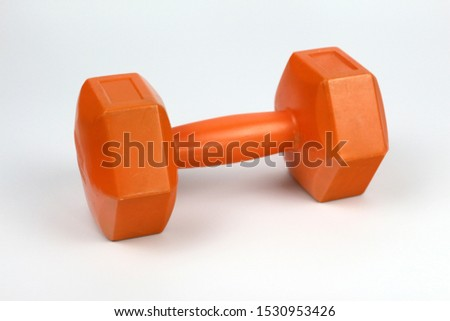 One dumb bell is on the white background, isolated weight barbell