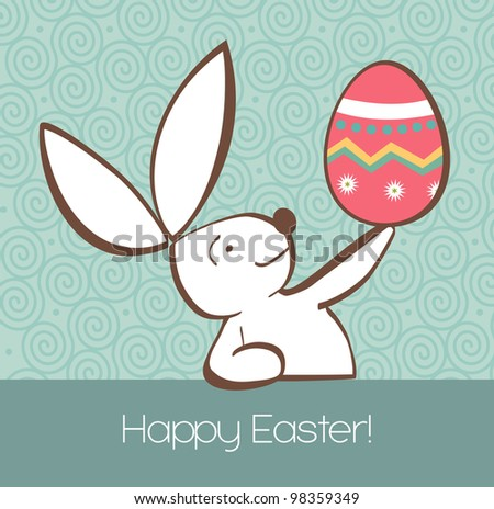 One Easter bunny with painted Easter egg in the hand on pastel green background.