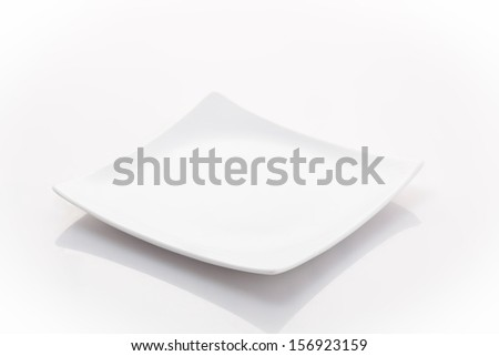 one empty square plate isolated on a white background