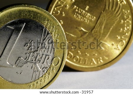 One Euro and One Dollar coin. Euro is in front and in focus.