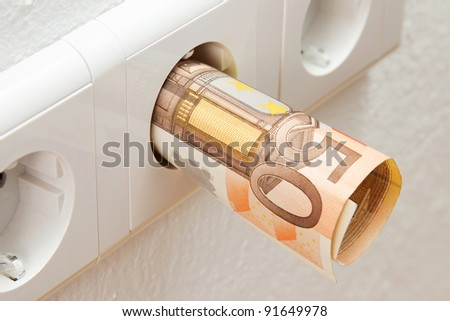 One Euro banknote in a socket