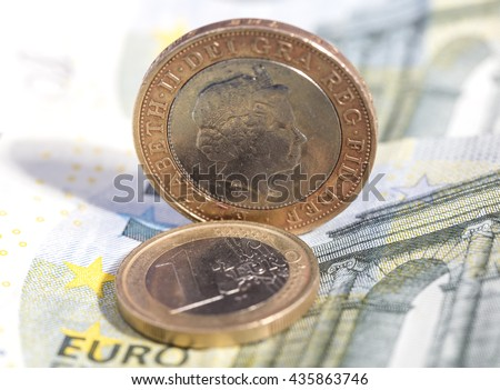 One euro coin and british pound on euro banknote
