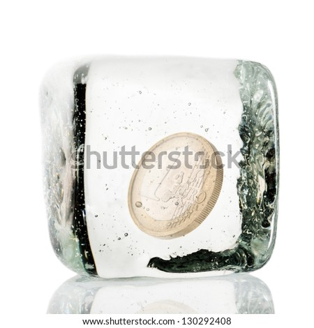One euro coin frozen in ice cube
