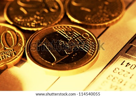 One Euro coin in gold tone. Selective focus.