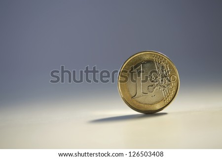 One euro coin isolated on blurry background