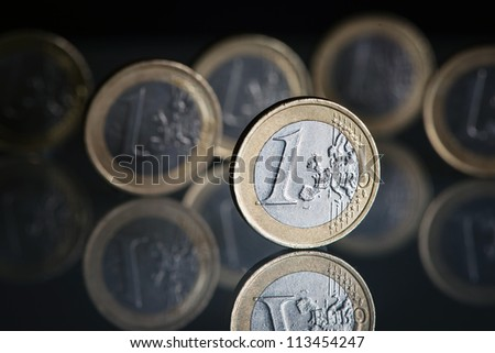 one euro coins on black background