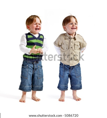 One face two emotions. Two very cute twin boys (smiling & crying) isolated on white background.