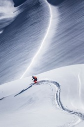 One freeride skier charging downhill through fresh and deep snow, Kuhtai Austria