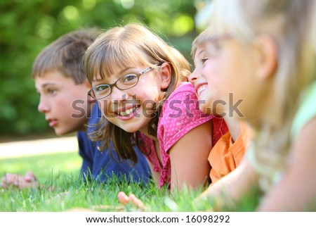One girl looking at camera in group of kids