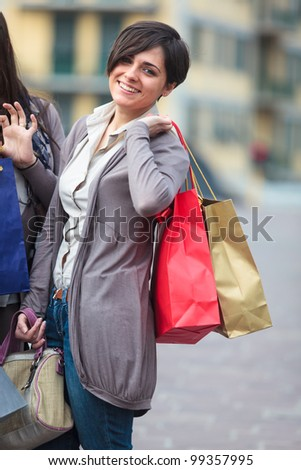 one girl make shopping with colored bags