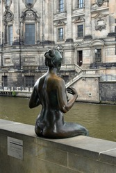 One girl of the Three Girls and a Boy sculpture along the Spree River in Berlin