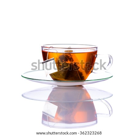 One glass Tea cup with tea-bag isolated on white background #362323268