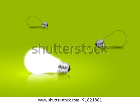 One glowing Light bulb from other on green background. Concept