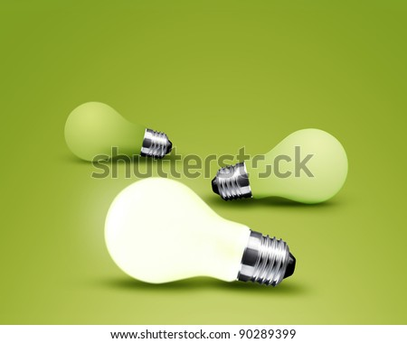 one glowing Light bulb from three Light bulb idea on green background
