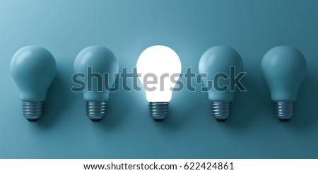 One glowing light bulb standing out from the unlit incandescent bulbs on green background with reflection and shadow , individuality and different business creative idea concepts . 3D rendering.