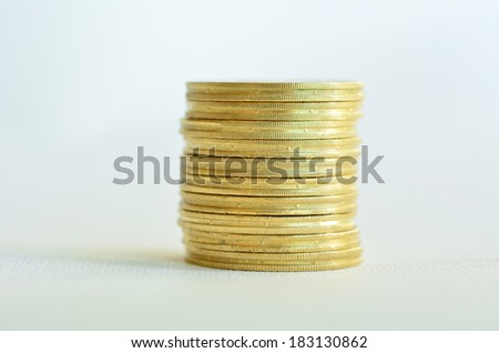 One Golden gold coins stack isolated on white background. Concept photo of bank, money, banking, finance, economy,  saving and loans (Isolated on white background) Horizontal - stock photo