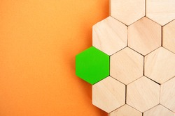 One green hexagon stands out from the rest. Leadership and victory concept. Dissimilarity and dissent. Uniqueness initiative. Superfluous, unsuitable. Going beyond. Untypical Concept