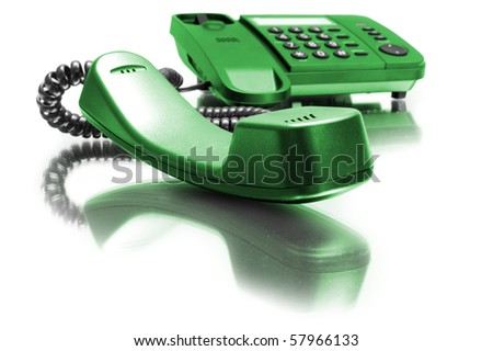 One green phone with mirror reflexion on white background