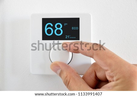 One hand adjust thermostat digital in fahrenheit at home