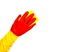 One hand in rubber glove clean with sponge white background. Red yellow rubber glove for everyday household chores. Female cleaning concept. Erasing from whiteboard clipart. Woman on housekeeping
