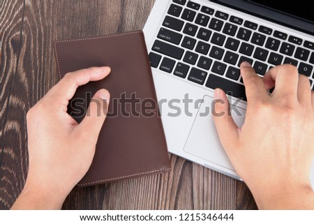 One hand, one wallet, one hand, one computer