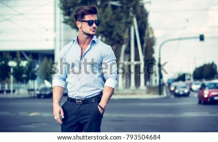One handsome elegant young man in urban setting in European city, standing #793504684