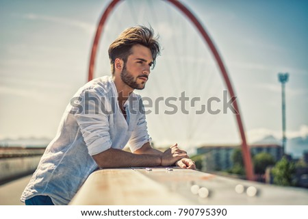 One handsome young man in urban setting in European city, standing #790795390