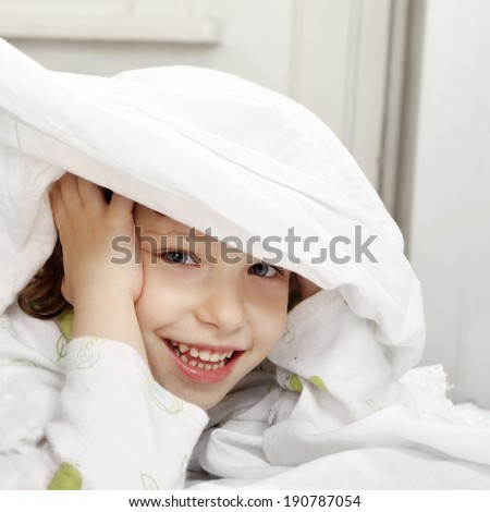 One happy child in the bed