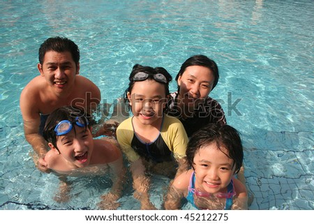 One happy family playing in the pool