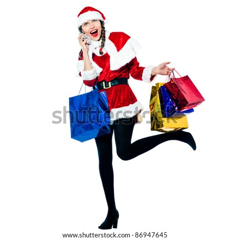 one happy woman dressed as santa claus carrying on the telephone christmas bags  on studio isolated white background