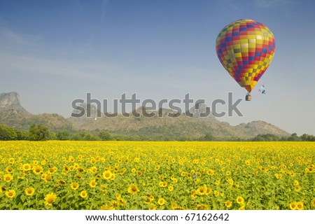 One hot air balloon over lake