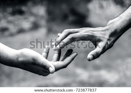 One human hand helping another hand to overcome his fear. Stock foto ©