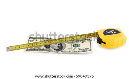 one hundred bill in US currency and tape measure isolated on white background