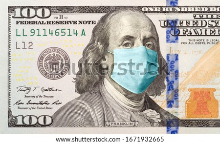 One Hundred Dollar Bill With Medical Face Mask on Benjamin Franklin. Stock photo ©
