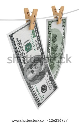 One hundred dollar bills is hanging on a rope with wooden clothespins on a white background