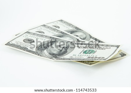 One hundred dollar bills, isolated on white background.